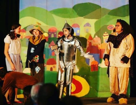 COURTESY OF  Maya Raman Maya Raman (center) as the Tin Man in the Roberta Jones Theater production of the Wizard of Oz.
