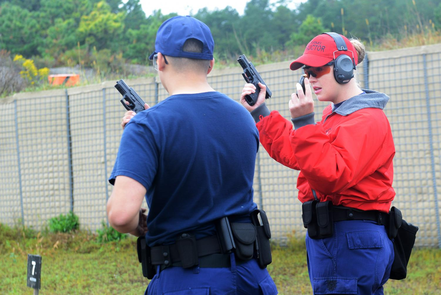 Courtesy of Coast Guard Compass.  Many schools now hire instructors for teachers, so they can handle guns safely during an emergency situation.